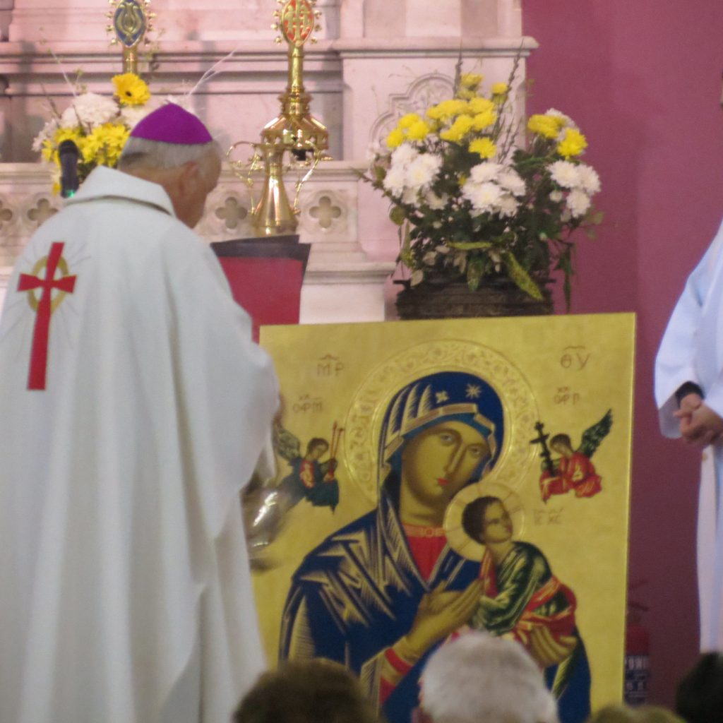 Bishop Brendan at prayer before the Icon of Mother of Perpetual Help